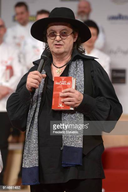 French chef Marc Veyrat poses with the 2018 Michelin Guide during the Michelin Award Ceremony 2018 at Philharmonie De Paris on February 5 2018 in...
