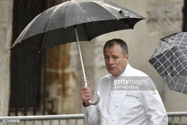 French chef Patrick Henriroux arrives to attend the funeral ceremony for French chef Paul Bocuse at the SaintJean Cathedral in Lyon on January 26...