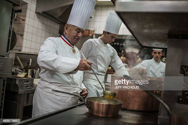 French chef Paul Bocuse at Collonges au Mont d'Or works in l'Aubergede Pont de Collonges kitchen during a culinary work shop on November 09 in Mont...