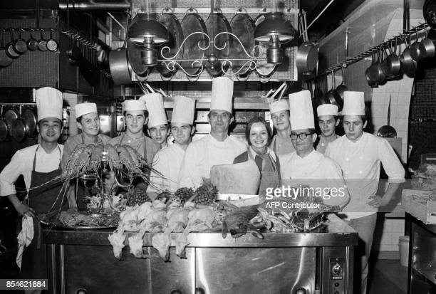 French Chef Paul Bocuse poses in the Kitchen of his restaurant in CollongesauMontd'Or near Lyon with his staff on November 15 1973 AFP PHOTO / AFP...
