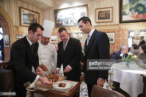 French Chef Paul Bocuse poses with waiters in his restaurant 'Paul Bocuse' on February 8 2011 in CollongesauMontd'Or near LyonFrance