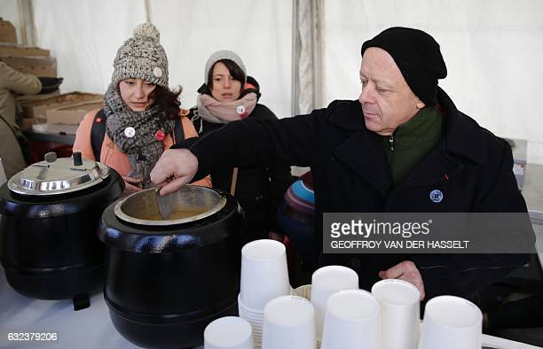 French chef Thierry Marx serves soup during an event marking the 10th anniversary of the death of Abbe Pierre founder of the Emmaus solidarity...