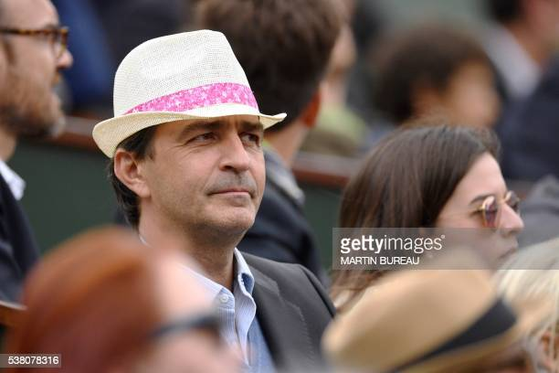 French chef Yannick Alleno attends the women's final match between Spain's Garbine Muguruza and the US's Serena Williams at the Roland Garros 2016...