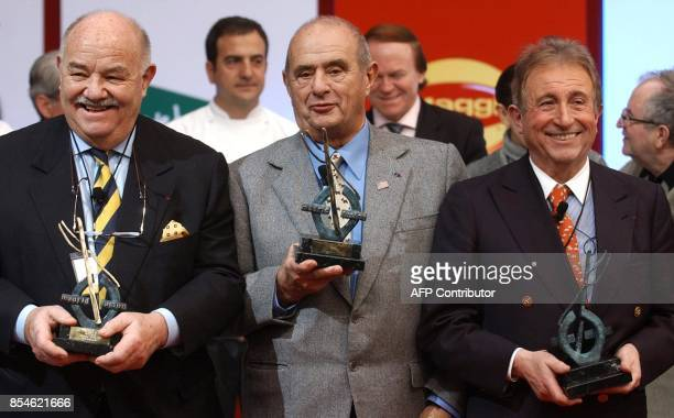 French 'Chefs' founders of the 'Nouvelle Cuisine' Pierre Troisgros Paul Bocuse and Michel Guerard show their trophies during the tribute awarded to...
