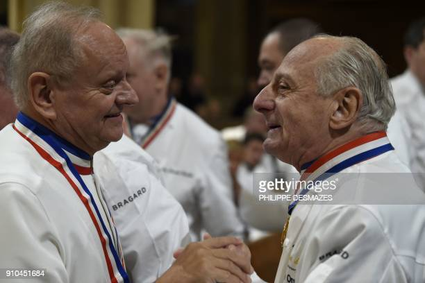 French chefs Joel Robuchon and Pierre Orsi talks upon their arrival to attend the funeral ceremony for French chef Paul Bocuse at the SaintJean...