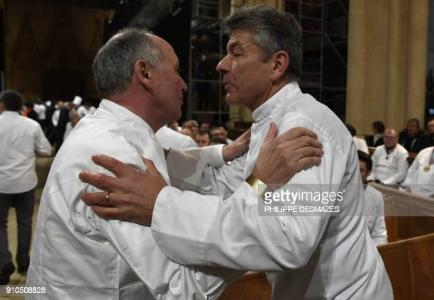 French chefs Marc Haeberlin and Regis Marcon arrive to attend the funeral ceremony for French chef Paul Bocuse at the SaintJean Cathedral in Lyon on...
