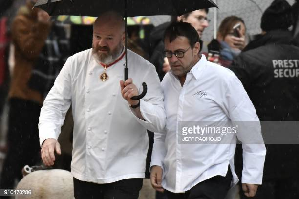 French chefs Philippe Etchebest and Michel Sarran arrive to attend the funeral ceremony for French chef Paul Bocuse at the SaintJean Cathedral in...