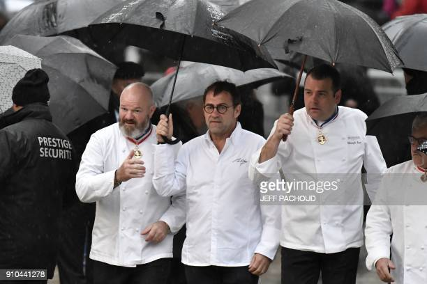 French chefs Philippe Etchebest Michel Sarran and Christophe Raoux arrive to attend the funeral ceremony for French chef Paul Bocuse at the SaintJean...