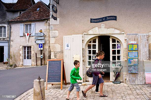 French children by souvenir shop in traditional French village of Angles Sur L'Anglin Vienne near Poitiers France