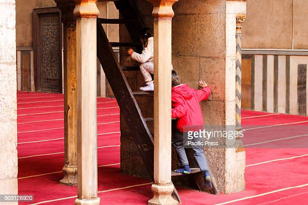 French children playing inside the Sultan Hassan Mosque in Cairo one of the monuments in Egypt In spite of the many attempts to restore tourism in...