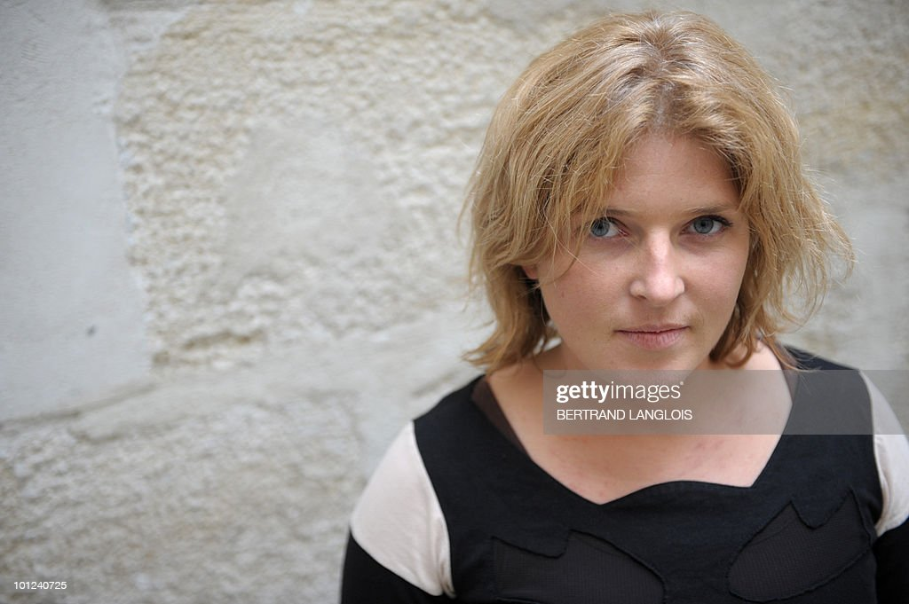 French Chloe Lemacon, widow of Florent Lemacon, poses on May 5, 2010 in Paris, at the Don Quichotte publishing house, on the eve of the release of her book 'Le Voyage du Tanit' (The Tanit Trip), telling the story of their trip on their boat 'Tanit' seized by Somali pirates on April 2009, in the Gulf of Aden. French army announced on May 5, 2010, that the French yachtsman Florent Lemacon was accidentally shot and killed by French special forces during their rescue operation to free the family. Four hostages including Lemacon's wife Chloe were freed in the operation.