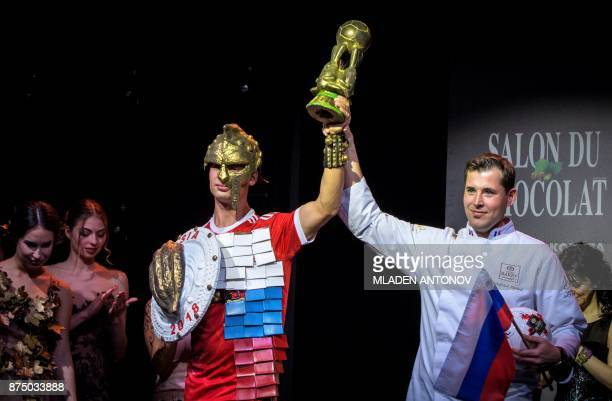 French chocolatier Wielfried Hauwel poses with models as he presents his creation related to the FIFA World Cup 2018 in Russia during the sixth...