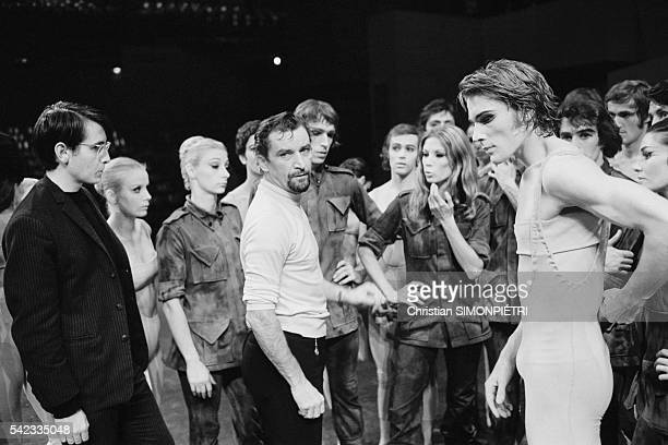French choreographer Maurice Bejart gives instructions during a rehearsal for the ballet L'Oiseau de Feu , created in Paris.