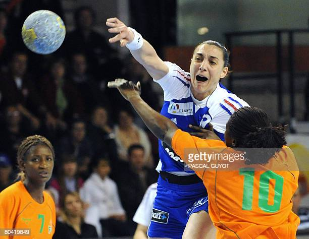 French Christine Vanparys fights for the ball with Ivory Coast's Abony N'Guessan Robeace on March 28 2008 in Nimes southern France during their...