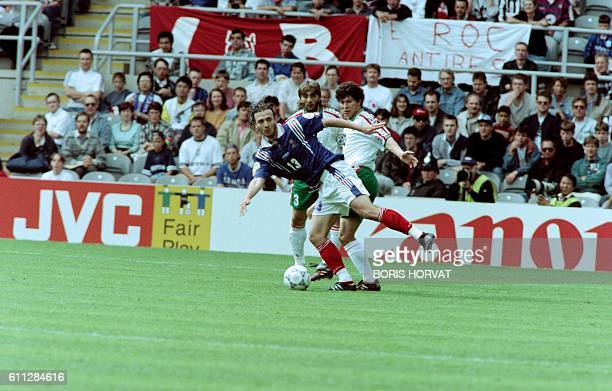 French Christophe Dugarry fights for the ball with Bulgarians Trifon Ivanov and Krasimir Balakov during the last match of the group B between France...