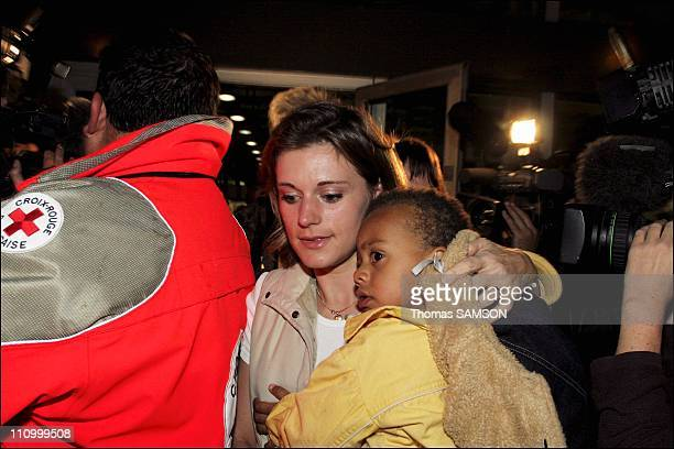 French citizens arriving at Paris airport after France began evacuating its citizens from Ivory Coast following clashes between French and Ivory...