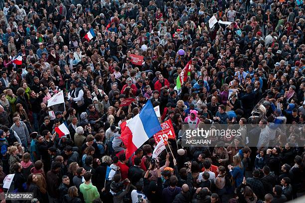 French citizens celebrate after Francois Hollande wins the French Presidential Elections on Place du Capitole on May 6 2012 in Toulouse France