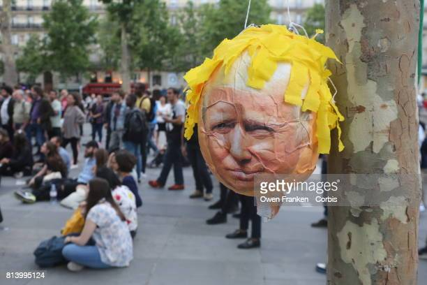 French citizens with some Americans hold an antiTrump rally in The Place de la Republiqueon July 13 2017 in Paris France