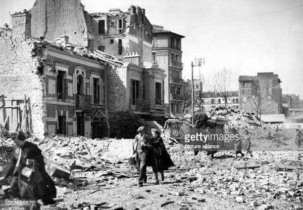 French civilians leave their destroyed houses in Paris, France, after an Anglo-American bomb raid on the German-occupied city, on 4 April 1943....