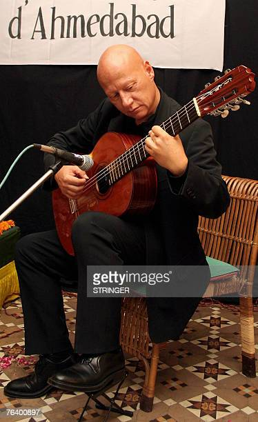 French classical guitarist Philippe Loli performs during a concert at House of Mangaldas in Ahmedabad 30 August 2007 The event was organised by The...