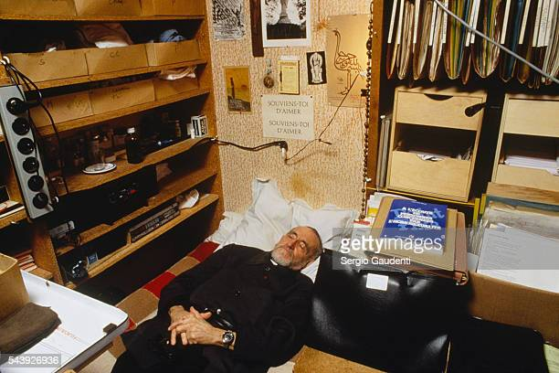 French clergyman Abbe Pierre takes a nap in his Charenton office