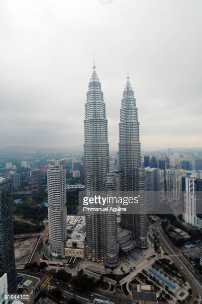 French climber Alain Robert aka 'Spiderman' climbs one of the Petronas Twin Towers on September 1 2009 in Kuala Lumpur Malaysia Robert climbed up the...