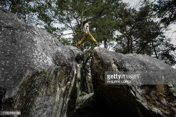TOPSHOT French climber Jeremy Bonder walks atop boulders during a demonstration of his skills at bouldering a form of rock climbing that is performed...