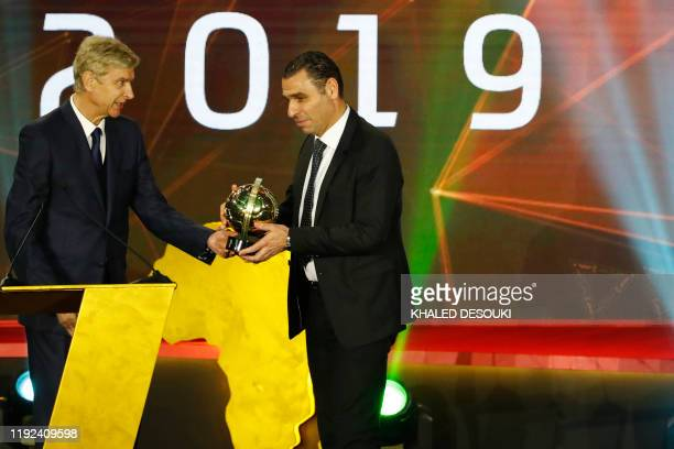 French coach Arsene Wenger presents the Goal of the Year award to Kheiredine Zetchi president of the Algerian Football Federation during the 2019 CAF...