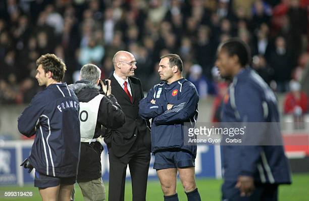 French coach Bernard Laporte talks to Raphael Ibanez after the IRB World Cup rugby bronze final between France and Argentina.