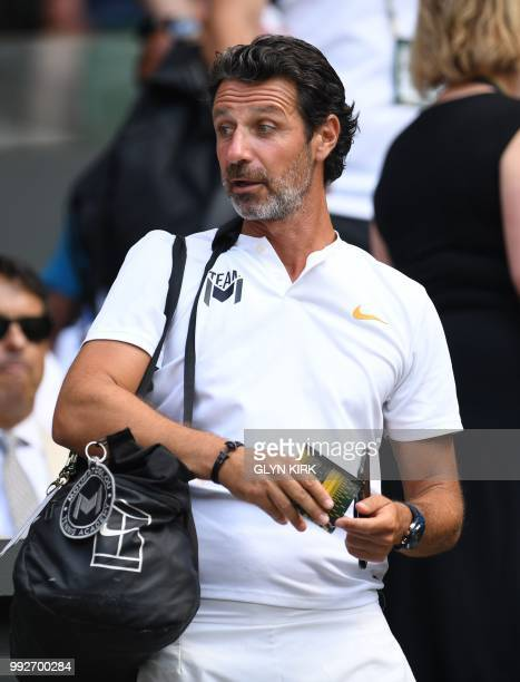 French coach Patrick Mouratoglou of Serena Williams arrives on centre court to watch her match against France's Kristina Mladenovic in the women's...