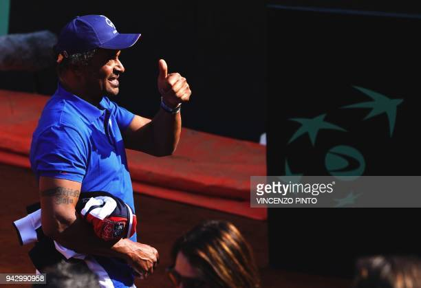 French coach Yannick Noah pushes a thumb up after France's Nicolas Mahut and teammate France's PierreHugues Herbert won the Davis Cup quarterfinal...