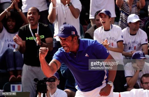 French coach Yannick Noah reacts during the Davis Cup quarterfinal doubles tennis match Italy vs France at the Valletta Cambiaso Camp in Genova on...