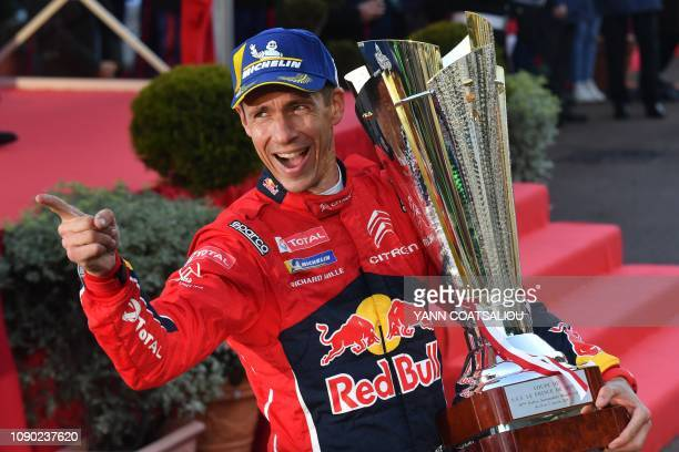 French codriver Julien Ingrassia celebrates as he holds the trophy after winning the 87th MonteCarlo Rally on January 27 in Monaco Reigning world...