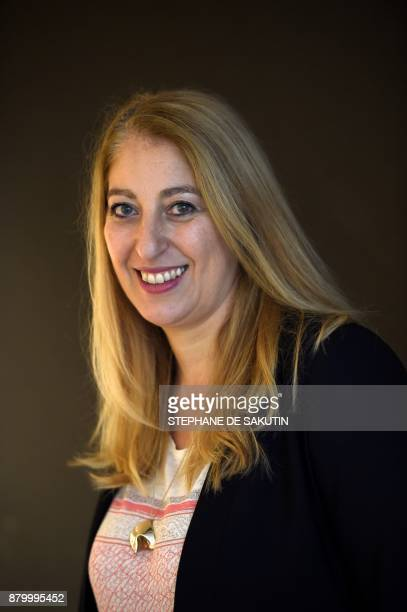 French cofunder of Habiteo Jeanne Massa poses during a photo session on November 17 2017 at the headquarters of the company in Paris / AFP PHOTO /...
