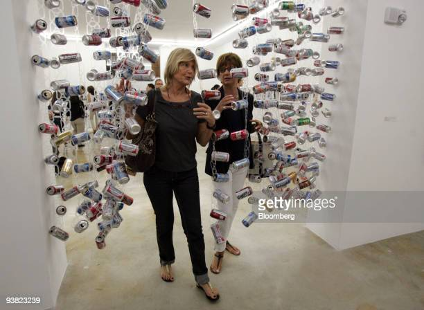 French collector Helene JourdanGassin left and photographer Mary Russell walk through 'The Final Curtain' by John Dogg at the Rubell Family...
