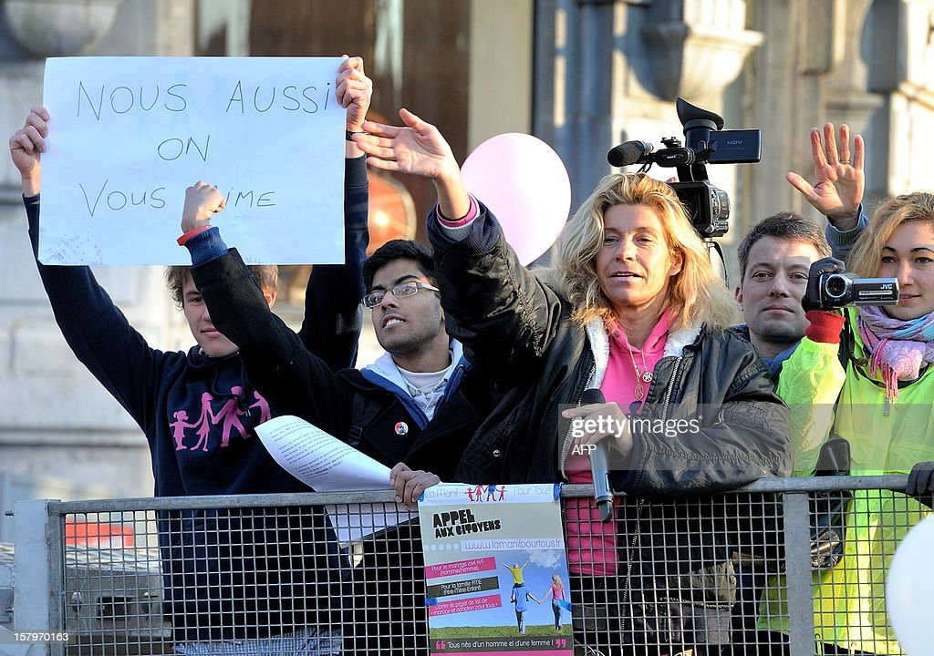 French comedian and Founder of association 'For a durable Humanity' Frigide Barjot waves during a demonstration against same sex marriages and the adoption of children by gay or lesbian couples in Lille, northern France on December 8, 2012.