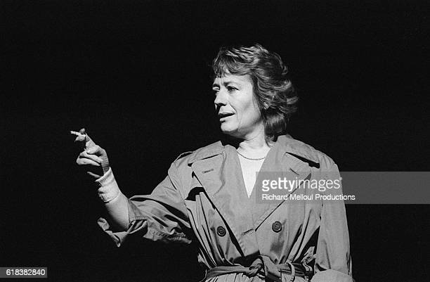 French comedian Annie Girardot smokes a cigarette as she performs in the play Marguerite et les autres at the Montparnasse theatre