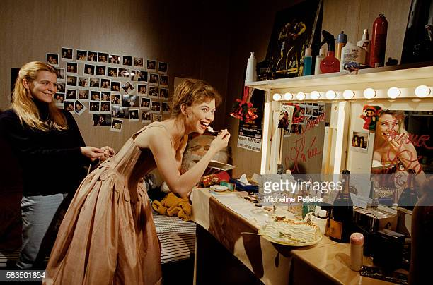 French comedian Dominique Sanda and her dresser in her dressing room during a production of the Oscar Wilde play An Ideal Husband at the Theatre...