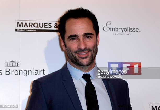 French comedian Florent Peyre poses as he arrives to attend the 25emes Trophees du Film Français awards ceremony at The Palais Brongniart in Paris on...