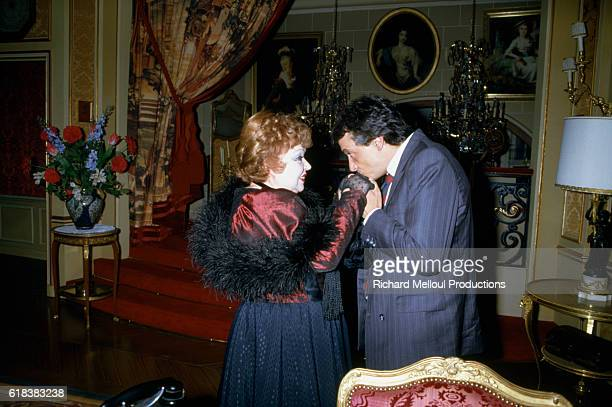 French comedian Jackie Sardou and her son the popular singer Michel Sardou on the set of Sacha Guitry's play N'Ecoutez Pas Mesdames In a gesture of...