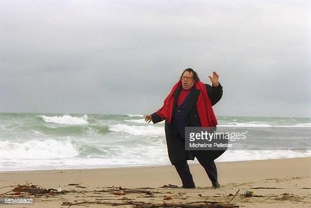 French comedian Raymond Devos on the beach.