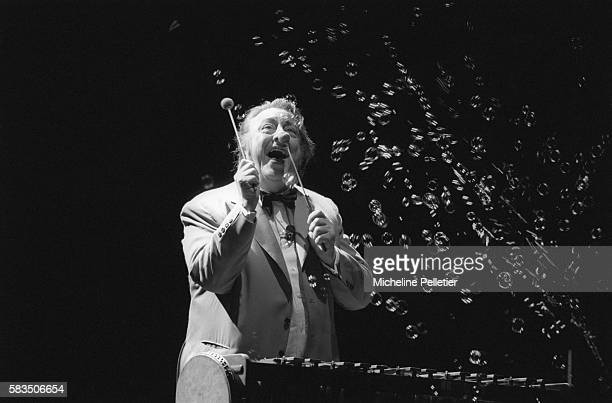 French comedian Raymond Devos plays the xylophone amid a flurry of bubbles during a live performance in Brussels.