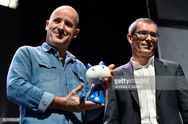 French comic book artist Etienne Davodeau and French writer and journalist Benoit Collombat pose after receiving the Fauve d'Angouleme Prix du Public...