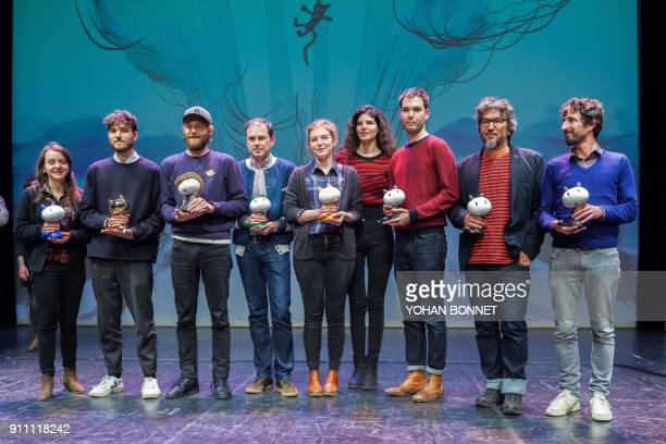 French comic book author Marion Montaigne holds her Cultura Public's Award and French comic book author Jeremie Moreau holds his Fauve d'Or best...