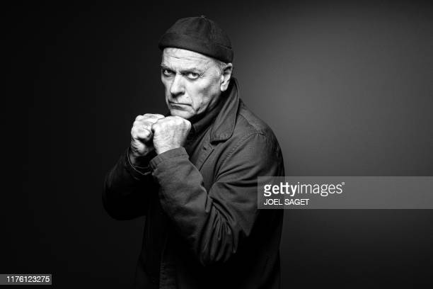 French comic books author and director Enki Bilal poses during a photo session in Paris on October 14, 2019.