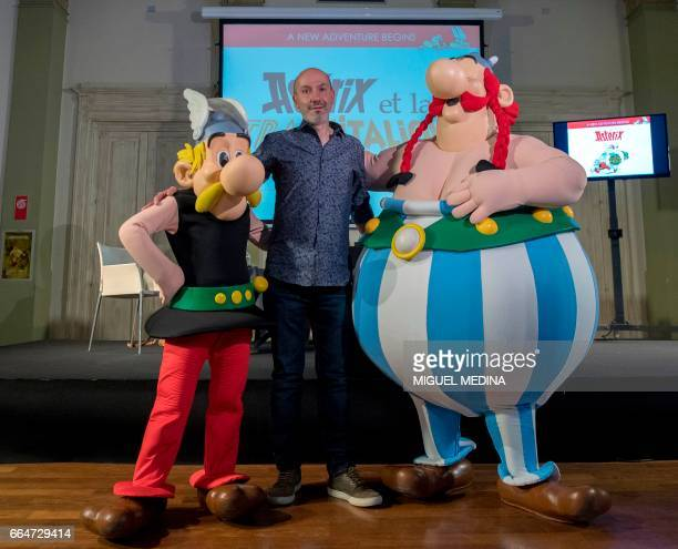 CORRECTION French comics writer designer and colourist JeanYves Ferri poses on April 5 2017 with characters Asterix and Obelix after a press...