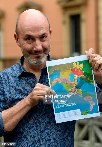 CORRECTION French comics writer designer and colourist JeanYves Ferri poses with the future front page of the 37th album of the Asterix series...