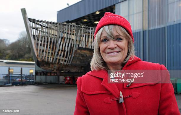 French commandant Cousteau's former wife Francine poses in front of La Calypso boat on March 4 2016 in Les Chantiers Piriou shipyard in Concarneau...