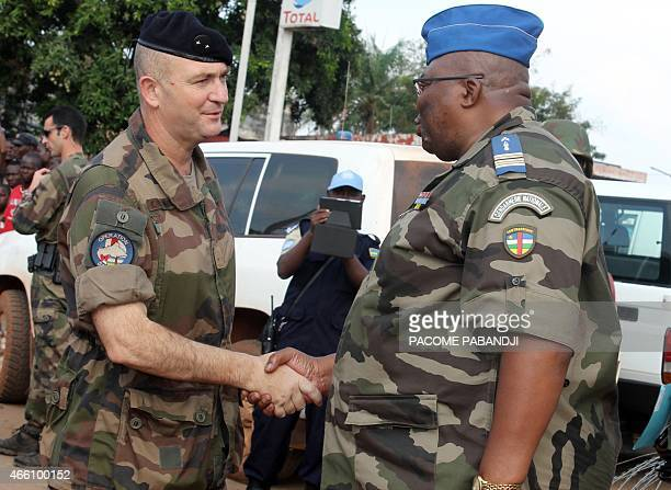 French commandant of the Sangaris operation Eric Bellot des Minieres shake hands with Commandant of the Centrafrican gendarmerie Guy Bertrand Damango...