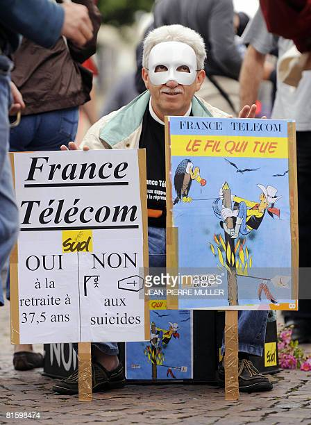 A French communication company France Telecom's worker waits in Bordeaux southwestern France on June 17 for the departure of the demonstration of...